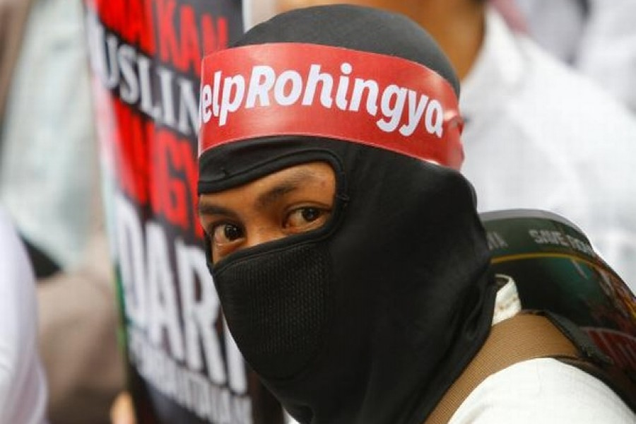 """A protester wears a headband with """"Help Rohingya"""" on it during a demonstration against what organisers say is the crackdown on ethnic Rohingya Muslims in Myanmar, outside the Myanmar embassy in Jakarta, Indonesia on November 25, 2016. –Reuters"""