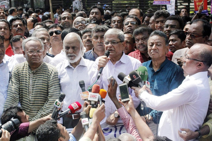BNP secretary general Mirza Fakhrul Islam Alamgir speaking at a human chain, as part of their  +98countrywide programme, protesting violence on Rohingya migrants in front of the National Press Club in the city on Friday.	— Focus Bangla
