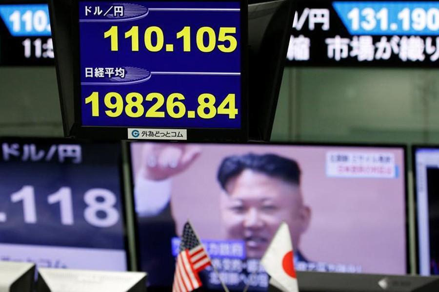 Asian stocks slip after missile tests