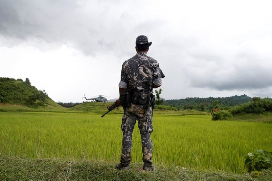 A Myanmar soldier stands near Maungdaw, north of Rakhine state, Myanmar September 27, 2017. Reuters
