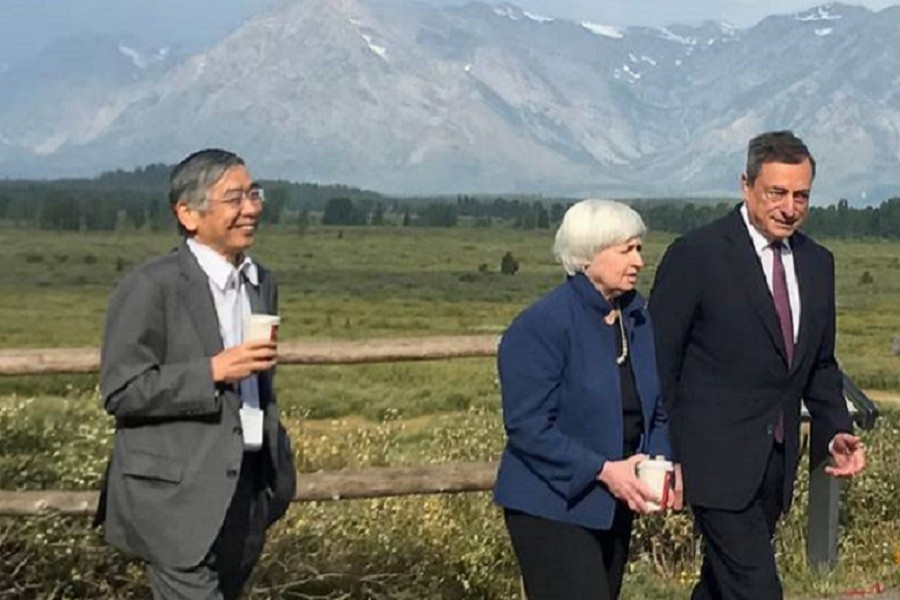 Heads of Japan, United States and Europe central banks walk after posing for a photo opportunity during the annual central bank research conference in Jackson Hole. Reuters/Files