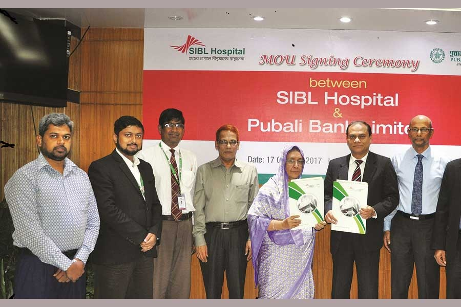 SIBL Hospital's Managing Director Dr. Lily Amin and Pubali Bank Limited's General Manager and Head of General Services & Development Division Abu Habib Khairul Kabir signed an agreement on behalf of their respective organisations.