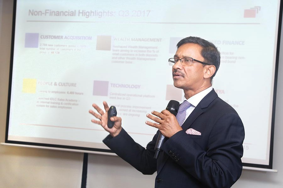 Managing Director of IDLC Finance Arif Khan disclosing the financial statement of Q3 in the city on Tuesday.