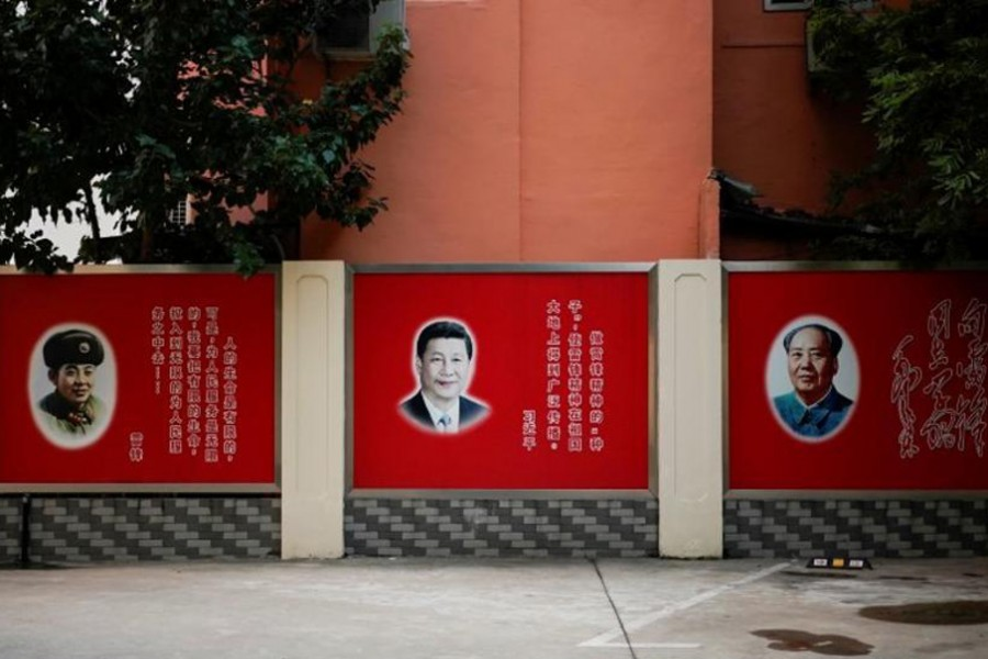 Pictures of Lei Feng, Xi Jinping and Mao Zedong overlook a courtyard in Shanghai, China. – Reuters photo