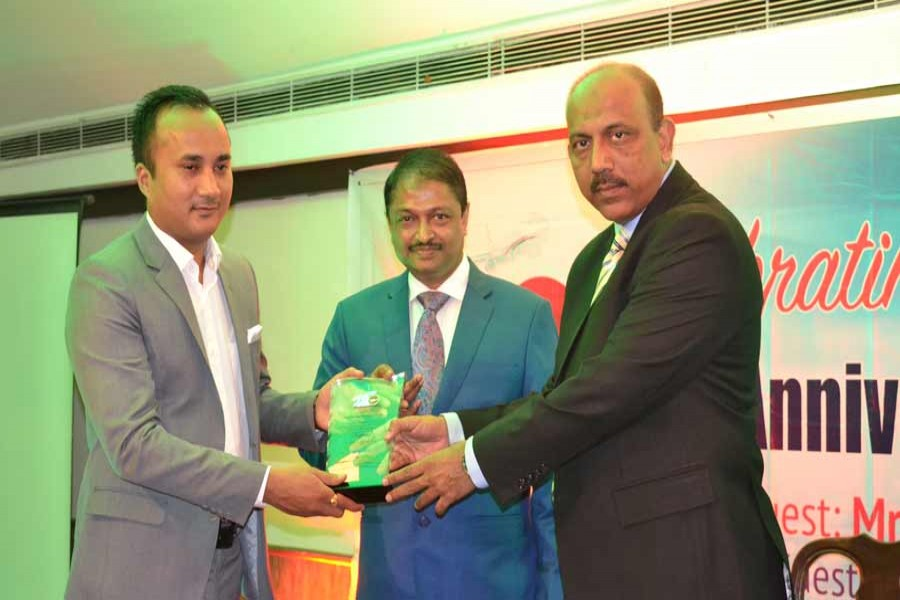 Biman Bangladesh Airlines Director (Marketing & Sales) M Ali Ahsan handing over a crest to a top sales agent in Nepal during a ceremony marking its 43 years of operations on Dhaka-Kathmandu-Dhaka route.