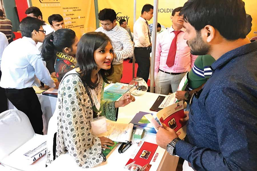 A visitor inquires about housing loan products at a three-day 'Housing Finance Fair-2017,' which began on Thursday in Dhaka. The Bangladesh House Building Finance Corporation is organising the fair.— FE Photo