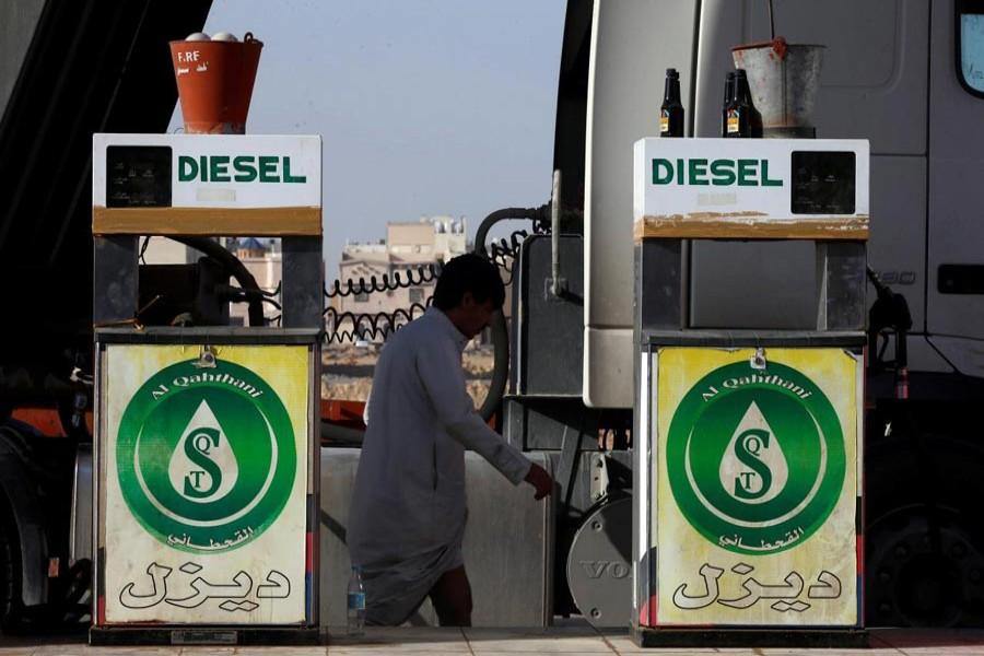 A man walks at a petrol station in Riyadh, Saudi Arabia recently. — Reuters