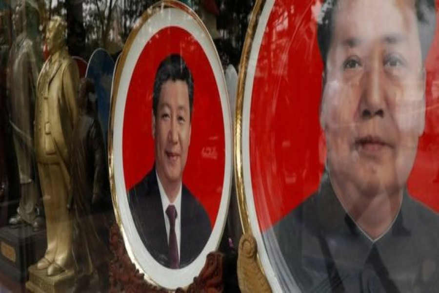 Souvenir plates bearing the images of China's President Xi Jinping and China's late Chairman Mao Zedong. Reuters