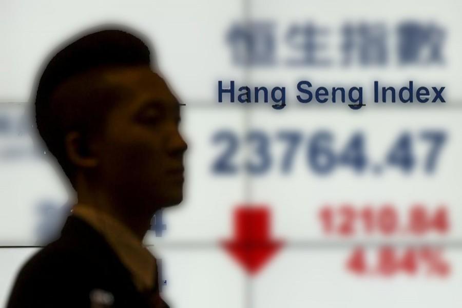 HK shares end week on firmer footing
