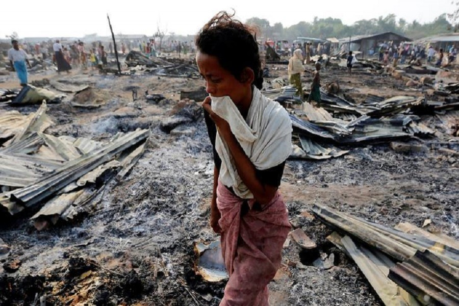 A woman walks among debris after fire destroyed shelters at a camp for internally displaced Rohingyas in the western Rakhine State near Sittwe, Myanmar May 3, 2016. Reuters/Files