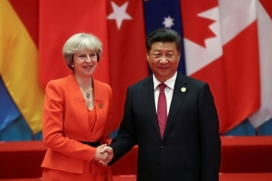 Chinese President Xi Jinping shakes hands with Britain's Prime Minister Theresa May during the G20 Summit in Hangzhou, Zhejiang province, China September 4, 2016. (REUTERS)