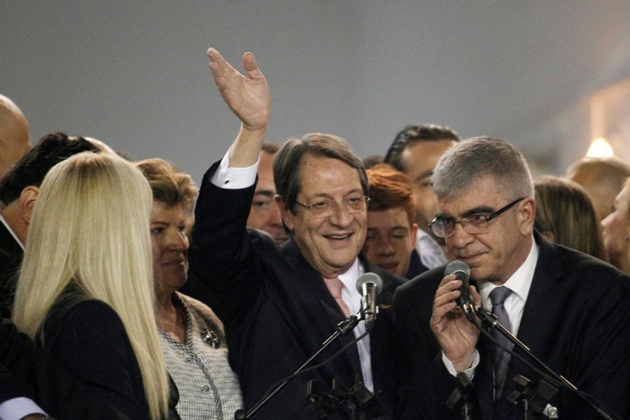 Newly elected president Nicos Anastasiades greets his supporters during a proclamation ceremony after the second round of the presidential election, at Eleftheria Hall in Nicosia, Cyprus, February 4, 2018. (REUTERS)