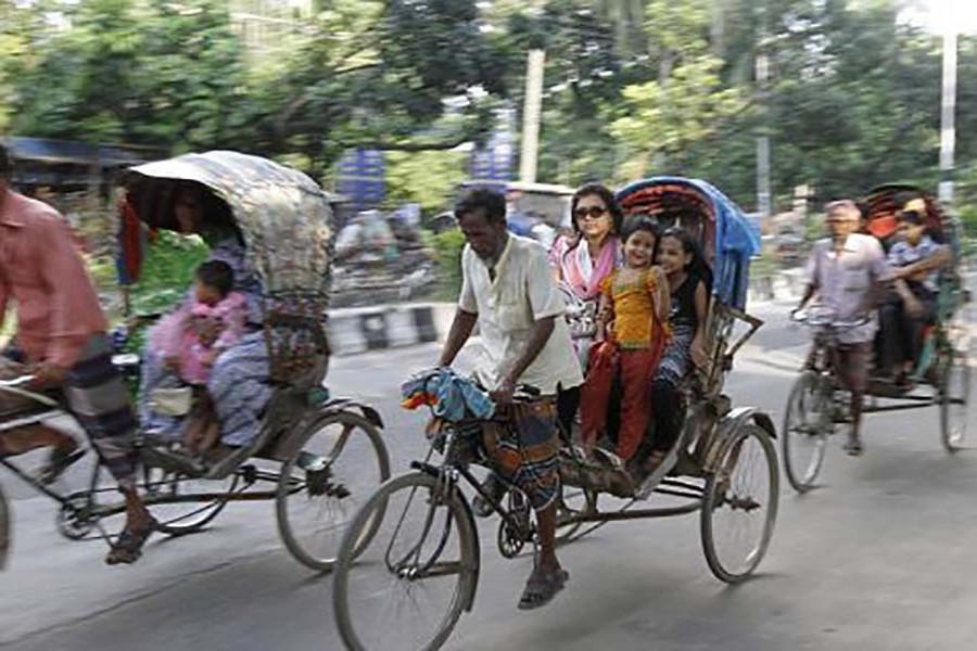 Slow moving rickshaws choking traffic