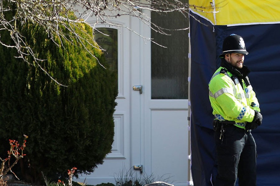 A police officer stands guard outside of the home of former Russian military intelligence officer Sergei Skripal, in Salisbury. Reuters.