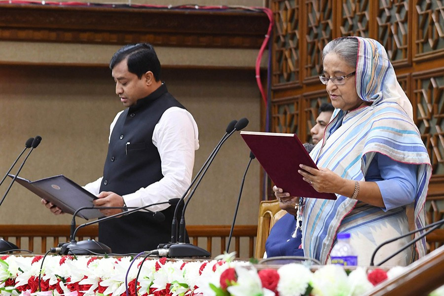 Prime Minister Sheikh Hasina and newly elected mayor of Gazipur City Corporation (GCC) Jahangir Alam during the oath taking ceremony. Focus Bangla photo