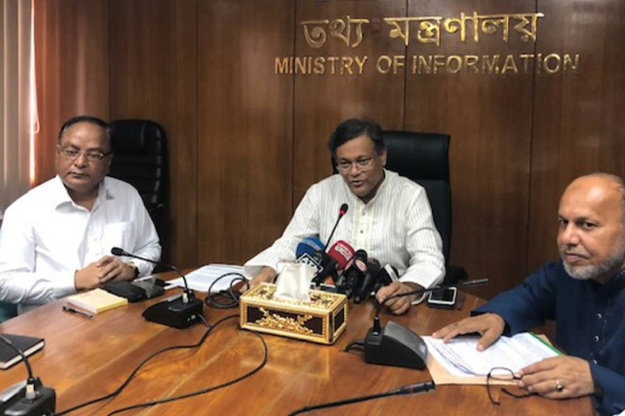 Information Minister Dr Hasan Mahmud (centre) talks to reporters during a views-exchange meeting with them at the Secretariat on Sunday — UNB photo