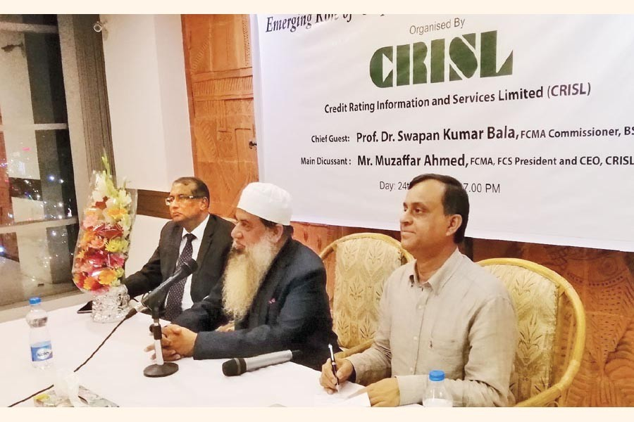 Muzaffar Ahmed , CEO, CRISL, addressing the seminar while Prof Dr. Swapan Kumar Bala (extreme right), Commissioner, BSEC, and Md. Asaduzzaman Khan (Extreme left), Executive Director, CRISL seen