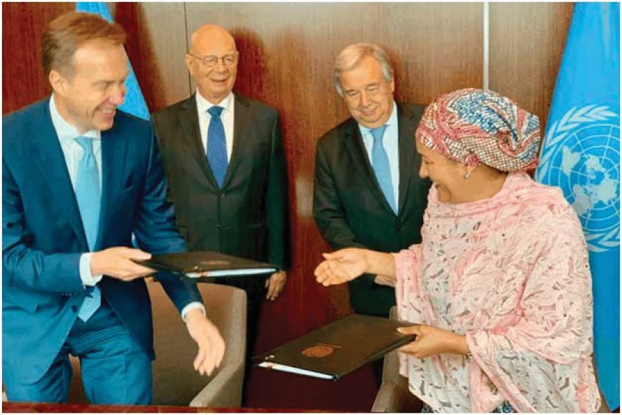 Amina Mohammed, right, the deputy secretary-general of the UN, signed a partnership agreement with the World Economic Forum, led by Borge Brende, left, to speed up progress on the Sustainable Development Goals. António Guterres, the UN secretary-general (behind Mohammed) and Klaus Schwab, the Forum's chief executive, joined the ceremony in June.