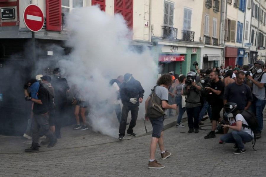 Demonstrators react after police used tear gas during a protest against G7 summit, in Bayonne. Reuters