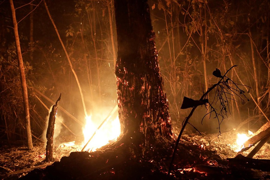 A tract of the Amazon jungle burns as it is cleared by loggers and farmers in Porto Velho, Brazil on August 24, 2019 — Reuters photo