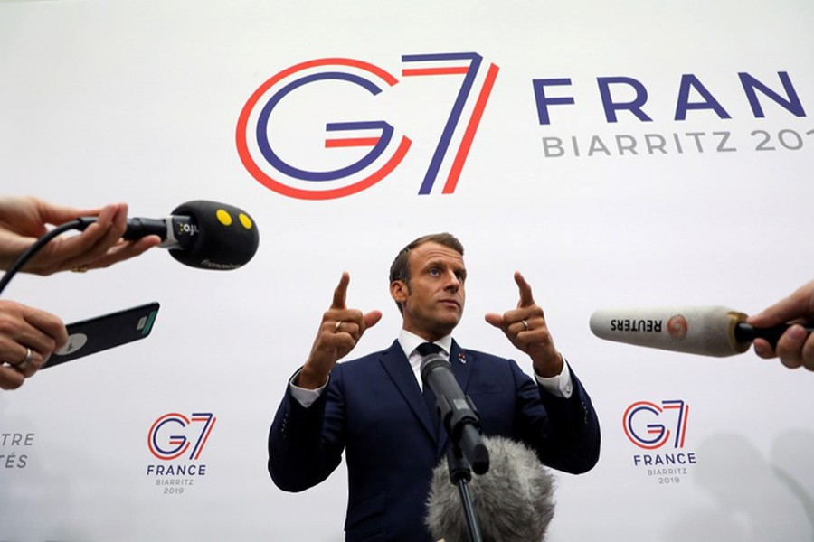 France's President Emmanuel Macron gestures as he speaks to the press after a plenary session at the Bellevue centre in Biarritz, France on August 25, 2019 — Reuters photo