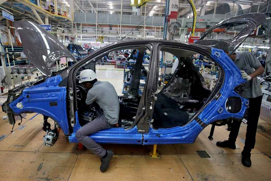 Workers assemble a Tata Tiago car inside the Tata Motors car plant in Sanand, on the outskirts of Ahmedabad, India, August 7, 2018. Reuters/Files