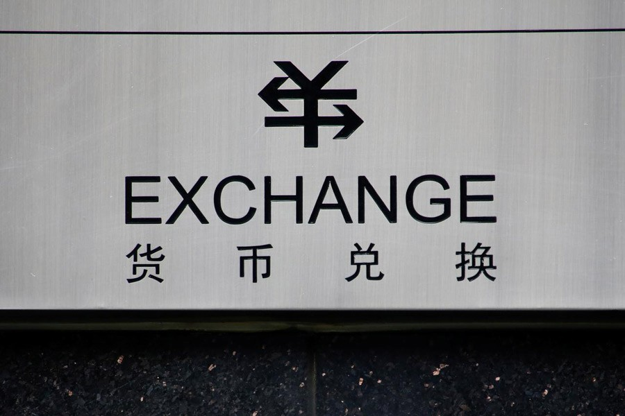 A sign for foreign currency exchange is seen at a branch of the ICBC bank in Beijing, China, January 3, 2017. Reuters/Files