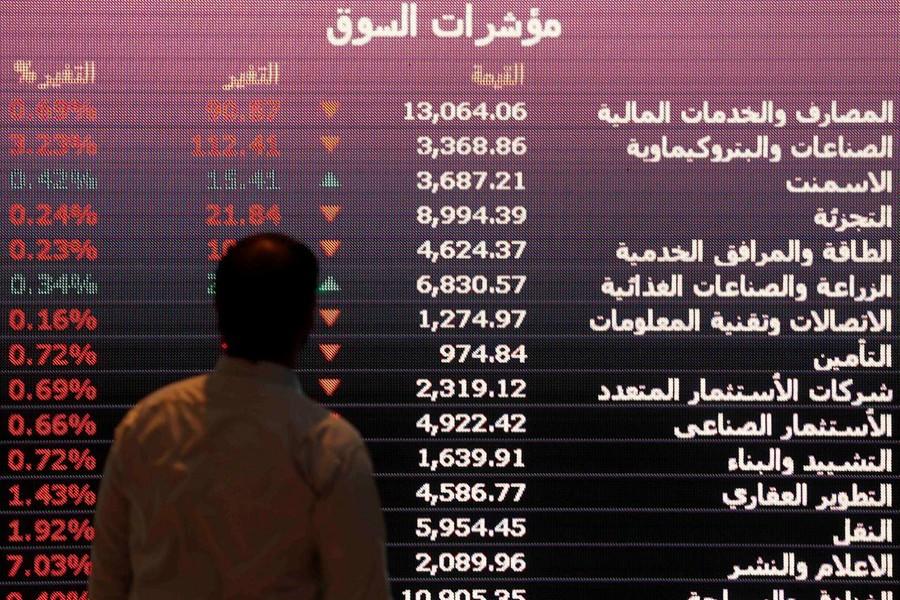 An investor monitors a screen displaying stock information at the Saudi Stock Exchange (Tadawul) in Riyadh, Saudi Arabia January 18, 2016 — Reuters/Files