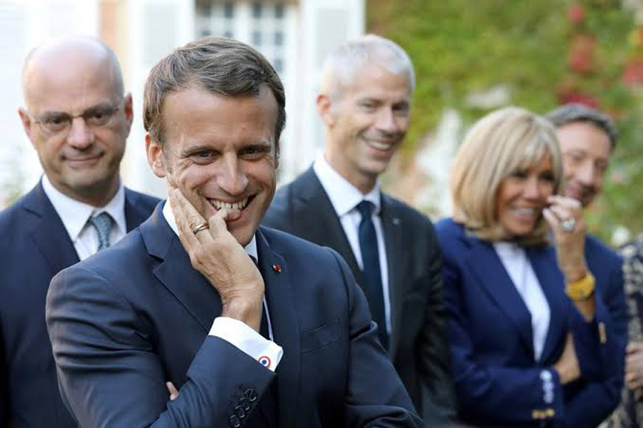 """French President Emmanuel Macron, French Education and Youth Affairs Minister Jean-Michel Blanquer, French Culture Minister Franck Riester and Macron's wife Brigitte Macron, speak with pupils visiting the Chateau de By (""""By Castle"""") in Thomery, France, September 20, 2019. Reuters"""