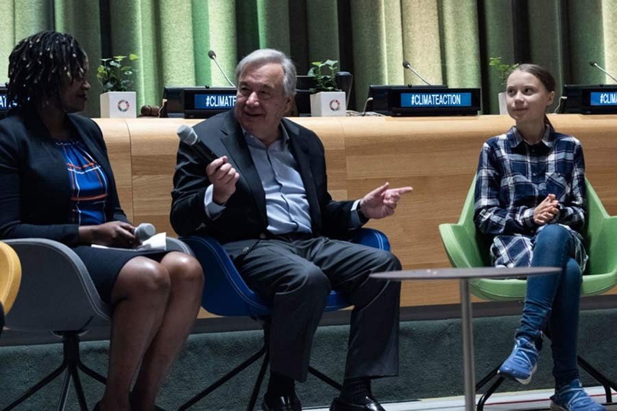 UN Secretary-General António Guterres (centre) and Greta Thunberg (right), Youth Climate Activist, at the opening of the UN Youth Climate Summit on September 21, 2019.  — Courtesy: UN Photo/Kim Haughton