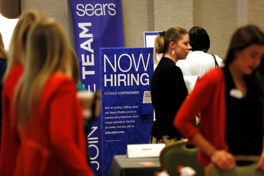 Recruiters and job seekers are seen at a job fair in Golden, Colorado, June 7, 2017. Reuters/Files