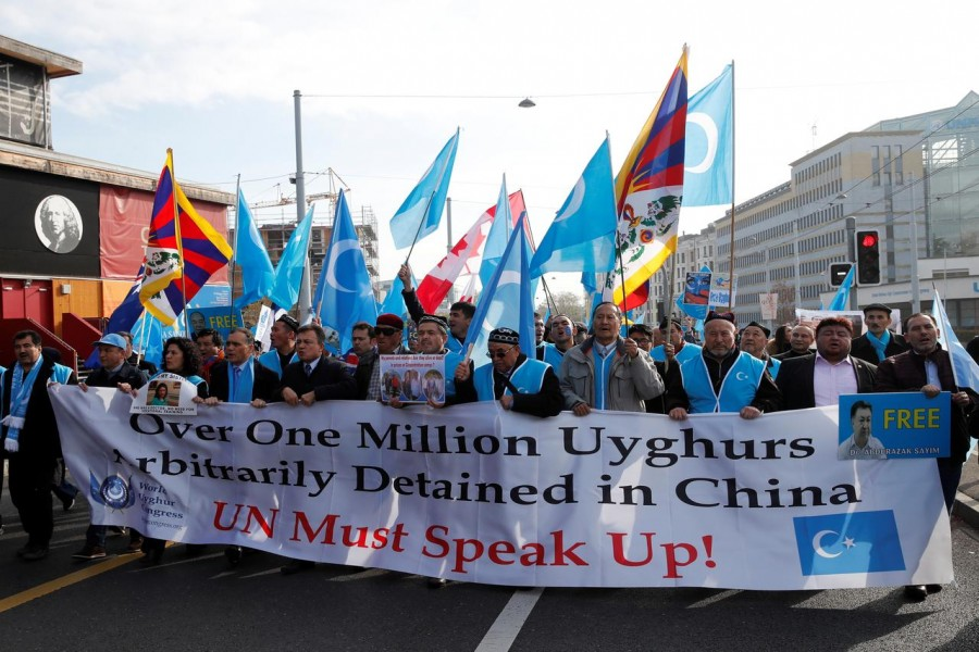 People demonstrate against China during its Universal Periodic Review by the Human Rights Council in front of the United Nations Office in Geneva, Switzerland, November 6, 2018. REUTERS/Denis Balibouse