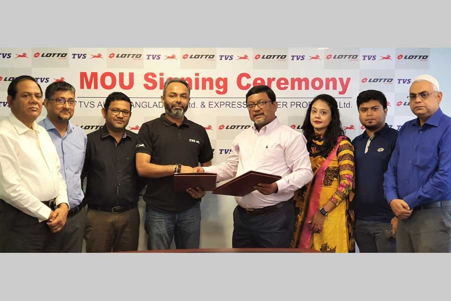Officials of Lotto and TVS Auto Bangladesh pose for photograph during the signing of an MoU in the city recently.