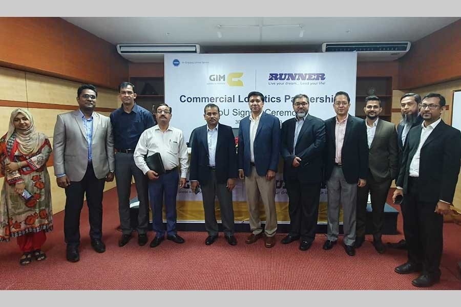 Officials of GIM Digital Truck and Runner Group pose for photograph during an MoU signing ceremony in the city recently.