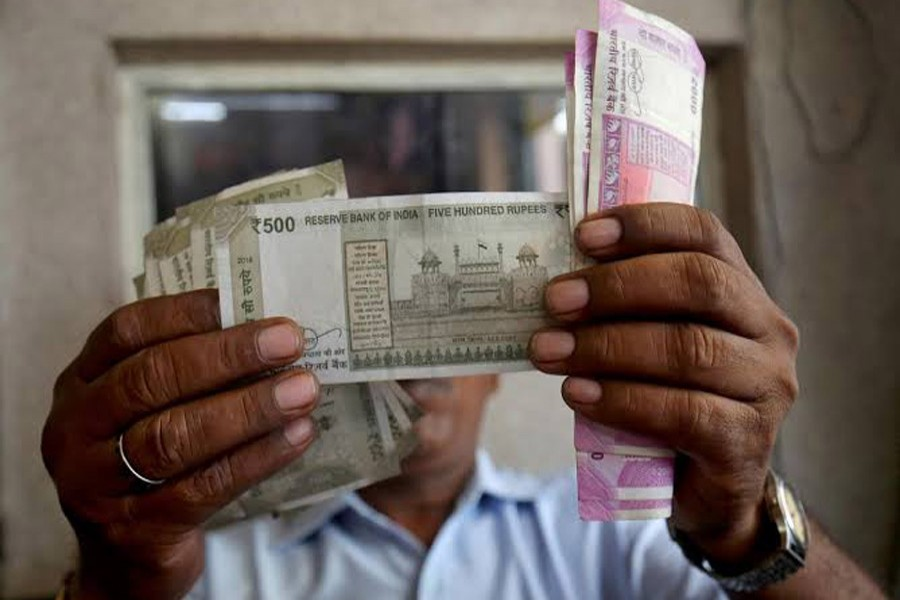 A cashier checks Indian rupee notes inside a room at a fuel station in Ahmedabad, India, September 20, 2018. Reuters/Files