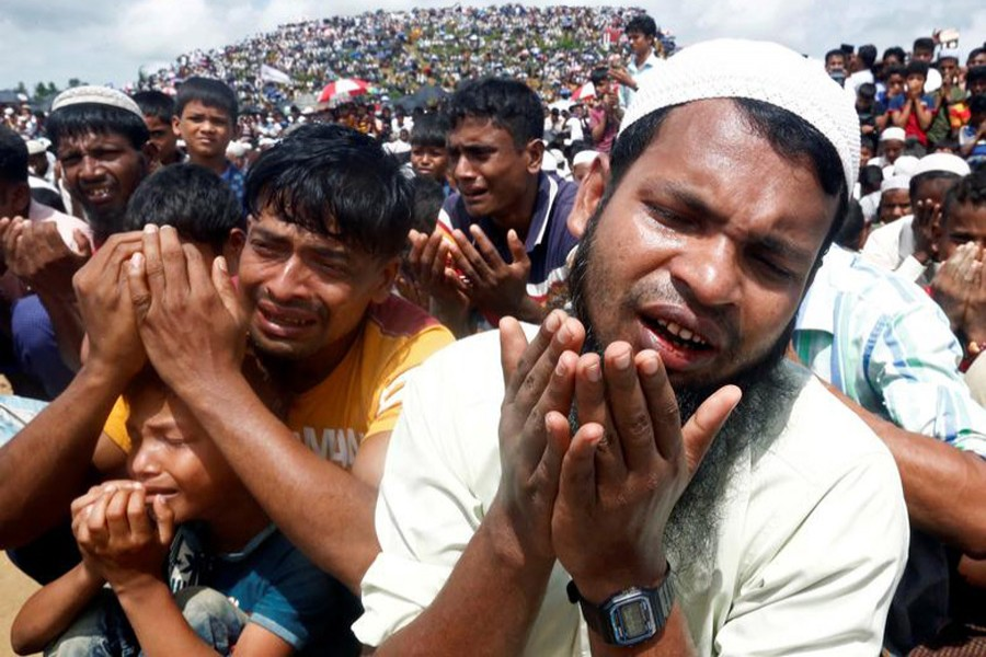 Rohingya refugees pray at a gathering marking the second anniversary of their exodus from Myanmar, at the Kutupalong camp in Cox's Bazar, Bangladesh, August 25, 2019. Reuters/File Photo