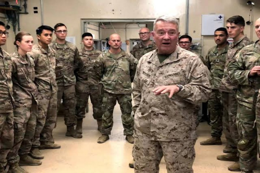 FILE PHOTO: Marine General Kenneth McKenzie, head of U.S. Central Command, speaks with U.S. troops while visiting Forward Operating Base Fenty in Jalalabad, Afghanistan, September 9, 2019. REUTERS/Phil Stewart/File Photo
