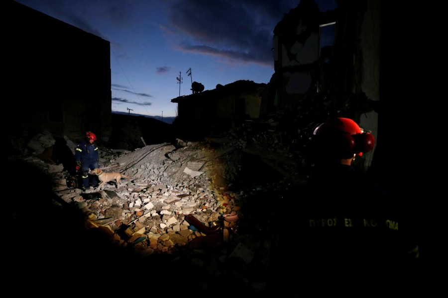 Emergency personnel from Greece work at a damaged building, following Tuesday's powerful earthquake, in Thumane, Albania, November 27, 2019. REUTERS/Florion Goga