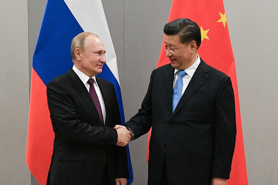 Russian President Vladimir Putin shaking hands with Chinese President Xi Jinping during their meeting on the sideline of the 11th edition of the BRICS Summit, in Brasilia, Brazil last month. -Reuters Photo