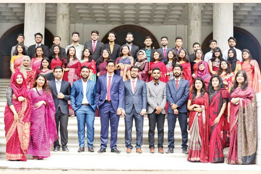 Members of Voice of Business with their President  Md Azmain Adil and Chief Editor Md Mishkat D Kabir in front of Senate Building, University of Dhaka