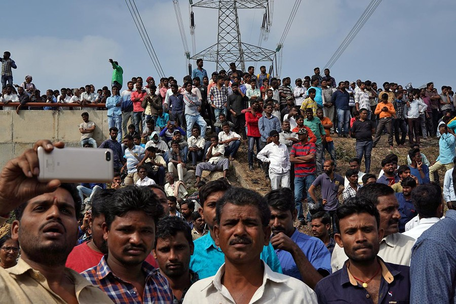 People gather at the site where police shot dead four men suspected of raping and killing a 27-year-old veterinarian, in Chatanpally on the outskirts of Shadnagar town, Telangana, India on December 6, 2019 — Reuters photo