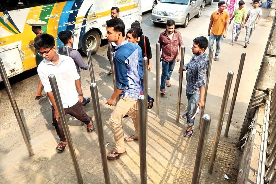 Freeing Dhaka of grabbing menace