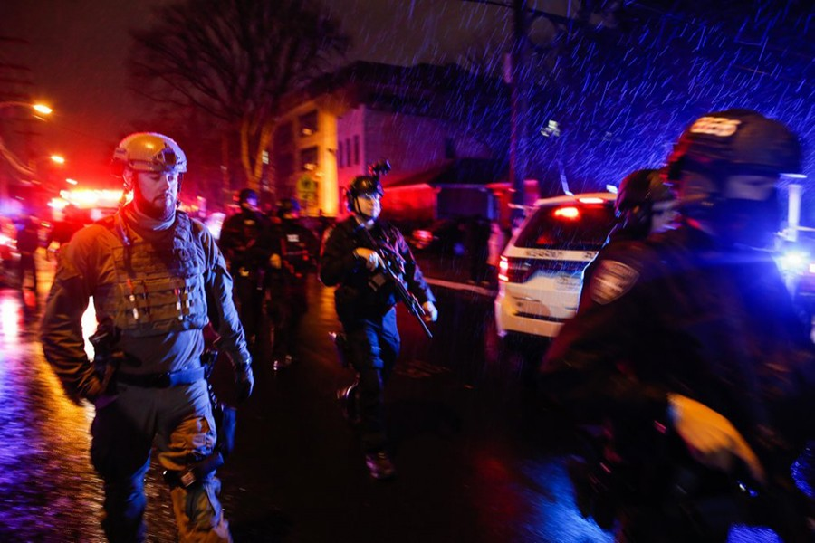 Law enforcement personnel walk near the scene following a shooting on Tuesday, December 10, 2019, in Jersey City, NJ — AP photo