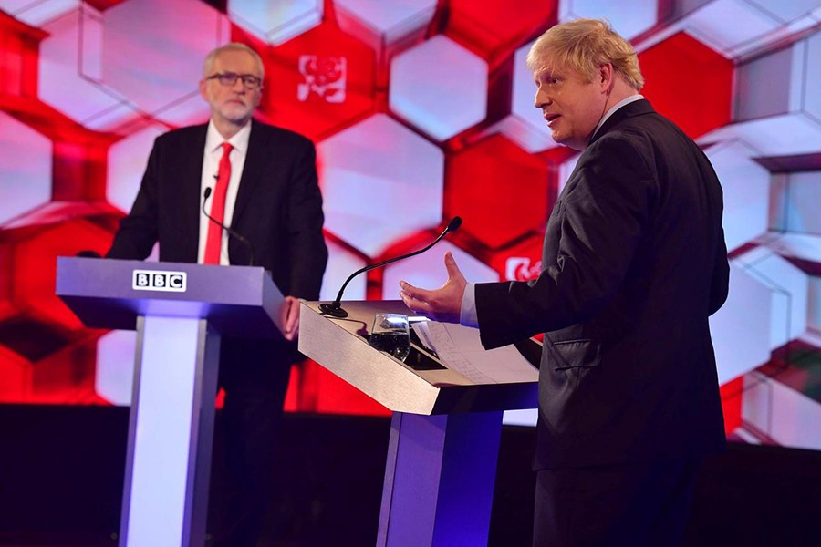 Britain's Prime Minister Boris Johnson and opposition Labour Party leader Jeremy Corbyn face each other in a head-to-head debate on the BBC in London, Britain on December 6, 2019 — Reuters photo