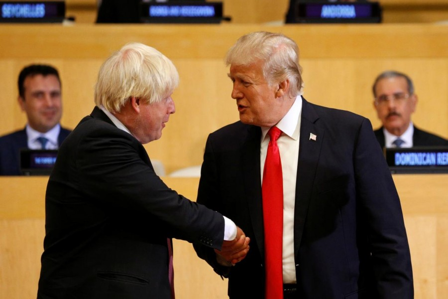 FILE PHOTO - U.S. President Donald Trump shakes hands with British Foreign Secretary Boris Johnson (L) as they take part in a session on reforming the United Nations at U.N. Headquarters in New York, U.S., September 18, 2017. REUTERS/Kevin Lamarque