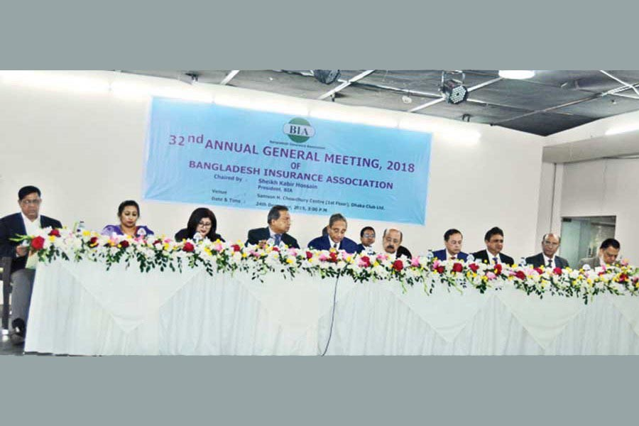 Sheikh Kabir Hossain, president, Bangladesh Insurance Association addressing the 32nd Annual General Meeting held on Tuesday at the Dhaka Club. Other members of the Executive Committee of BIA are also seen