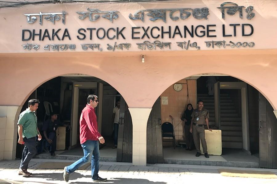 Pedestrians walk past the Dhaka Stock Exchange office building at Motijheel in Dhaka — FE/Files