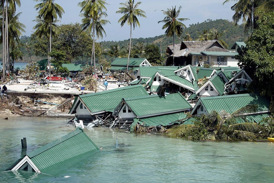 Submerged buildings are seen near the pier at Ton Sai Bay in Thailand's Phi Phi island on December 28, 2004 after a tsunami hit the area — Reuters/Files