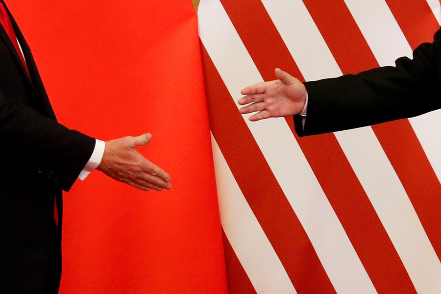 US President Donald Trump and China's President Xi Jinping shake hands after making joint statements at the Great Hall of the People in Beijing, China, November 9, 2017 — Reuters/Files