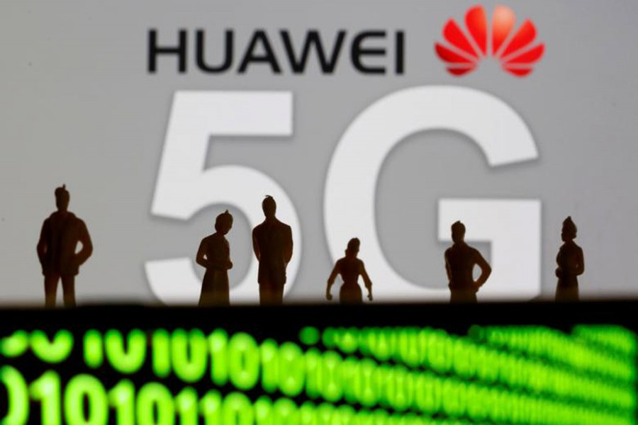 Small toy figures are seen in front of a displayed Huawei and 5G network logo in this illustration picture, March 30, 2019. Reuters/Illustration